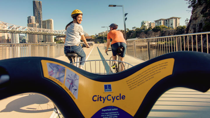 Three people riding on Brisbane CityCycle bikes
