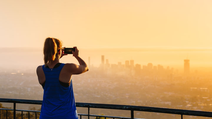 Girl taking photos of the sunrise