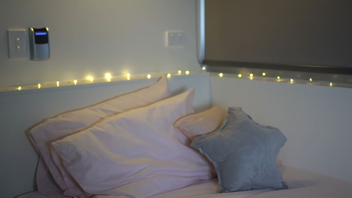 Fairy lights around a bed